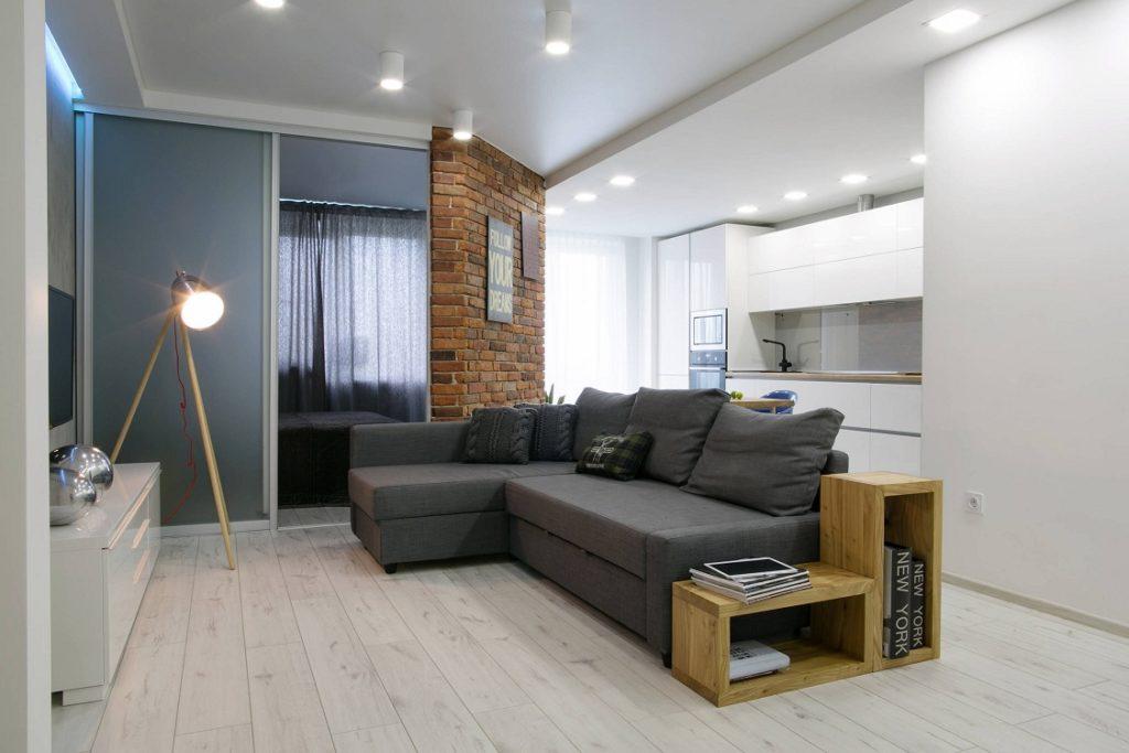 Освещение кухни-гостиной с диваном посередине