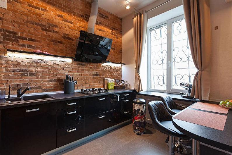 Черная кухня в стиле лофт в городской квартире