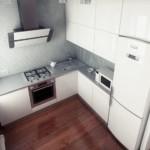Наклонная вытяжка на стене кухни с отделкой из мелкой плитки