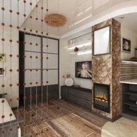 Коричневый пол из ламината в кухне-гостиной