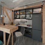 Серый холодильник в маленькой кухне
