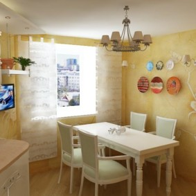 Люстра над обеденным столом в кухне
