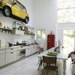 Красный холодильник в белой кухне