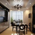 Черная люстра на потолке кухни