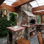 Облицовка печи камнем в летней кухне