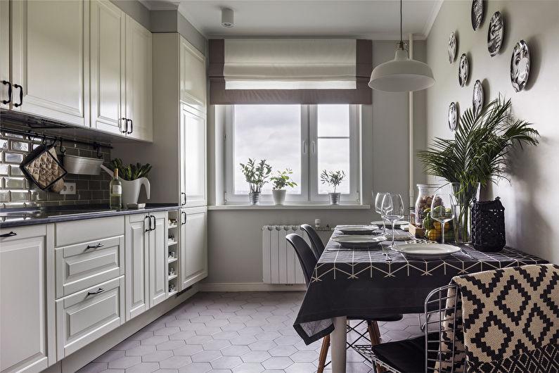 Керамический пол в кухне с римской шторой на окне