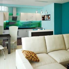 Дизайн кухни-гостиной с голубыми стенами