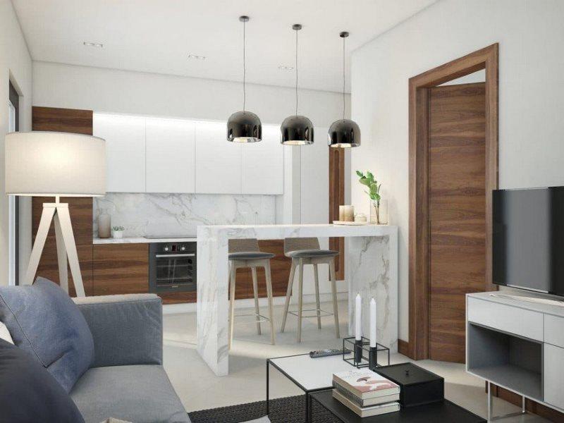 Барная стойка белого цвета в кухне-гостиной