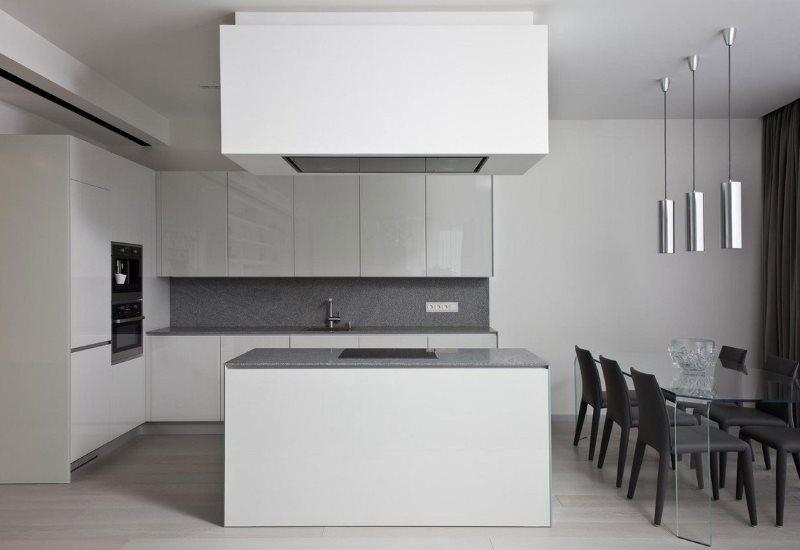 Белая кухня с островом в стиле минимализма