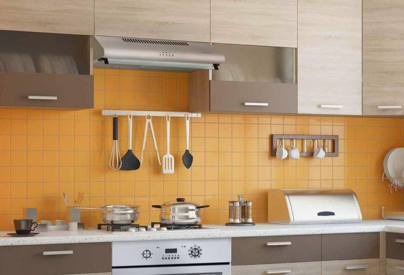 Подвесная вытяжка на кухне с желтым фартуком