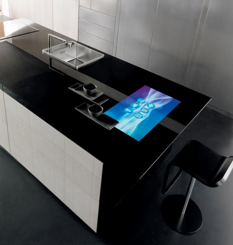 Сенсорная панель в черной столешнице на кухне в стиле хай-тек