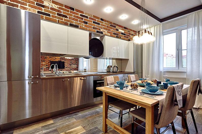 Линейная кухня в стиле лофт с фасадами из нержавейки
