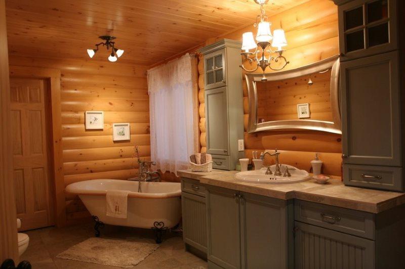 Серые фасады деревянной мебели в ванной