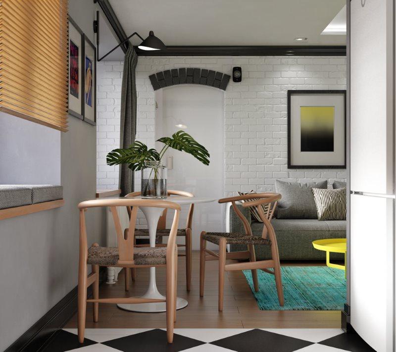 Деревянные стулья в обеденной зоне кухни-гостиной