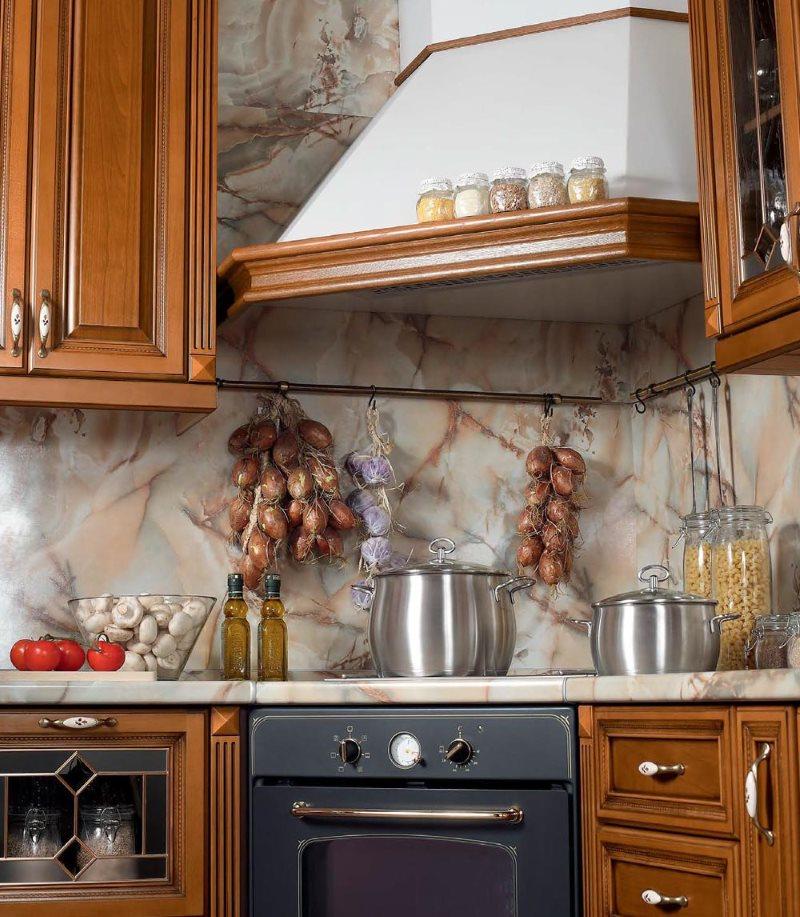 Каминная вытяжка углового типа в деревенской кухне