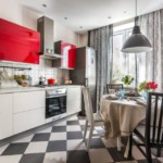 Красно-белый гарнитур в угловой кухне