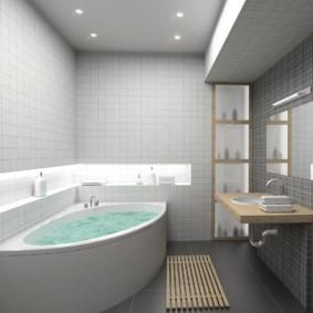 Угловая ванна с водой в комнате с серыми стенами