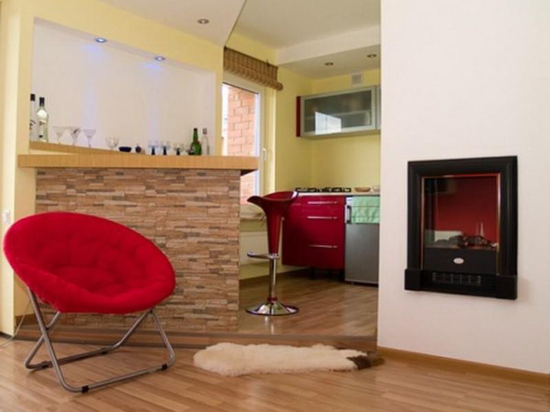 Выделение рабочей зоны кухни-гостиной подиумом
