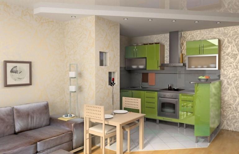 Зеленый гарнитур в кухне-гостиной с прямым диваном