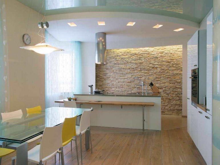 Островная вытяжка на потолке кухни-гостиной