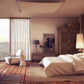 спальня с двумя окнами идеи интерьер