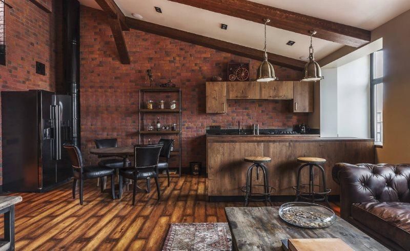 Интерьер просторной кухни-гостиной в стиле лофт