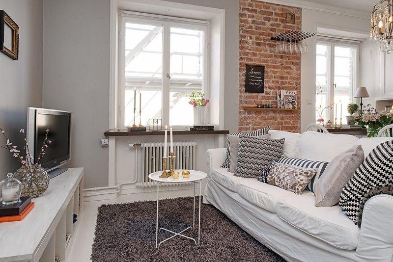 Обустройство зоны отдыха в кухне-гостиной скандинавского стиля