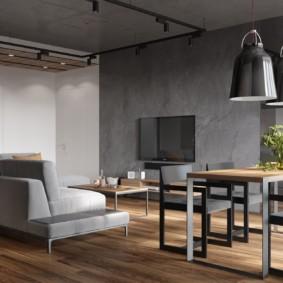 Серый диван в комнате с бетонными стенами