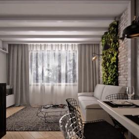 Зеленые растения на стене гостиной