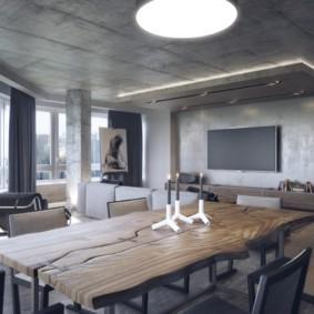 Бетонные поверхности в интерьере кухни-гостиной
