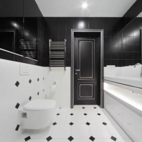Черный верх и белый низ в ванной комнате