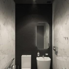 Белая раковина на фоне темной стены