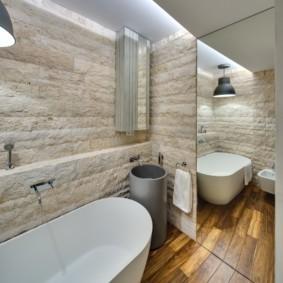 Облицовка стен ванной природным камнем