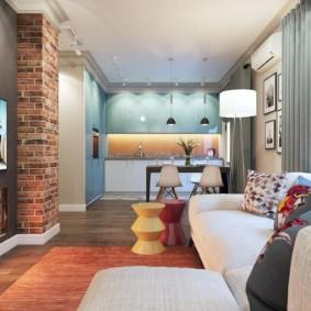 Дизайн кухни-гостиной с кирпичной стеной