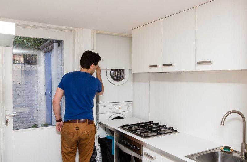 Место для стиральной машинки в нише кухни