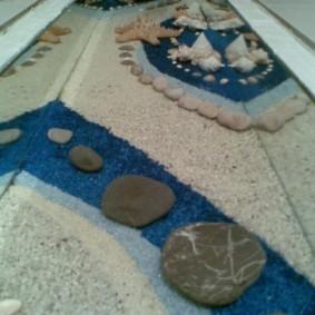 Галька и песок под эпоксидным покрытием наливного пола