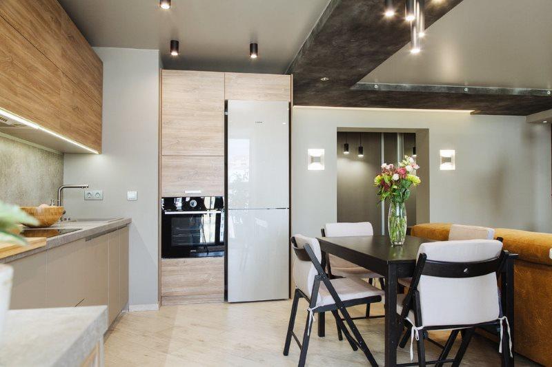 Зонирование кухни-гостиной двухъярусным потолком