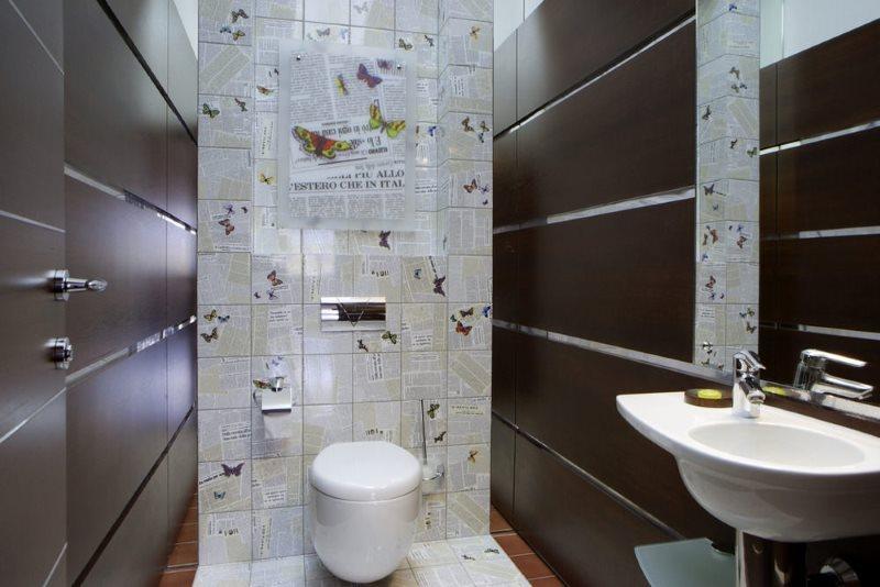 Черная плитка крупного формата на стене туалетной комнаты