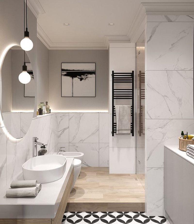 Черный полотенцесушитель с рейлами в бежевой ванной комнате