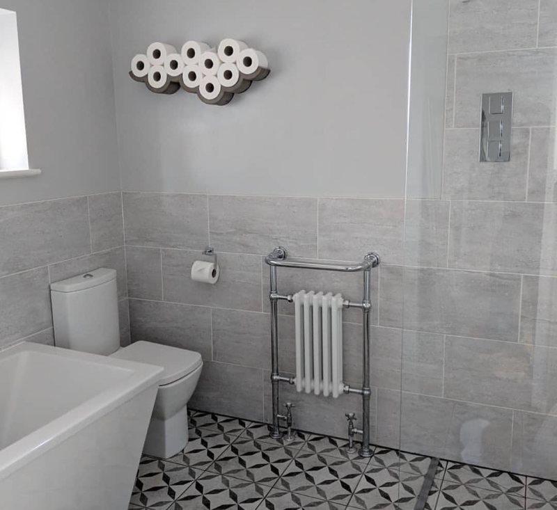 Полотенцесушитель-батарея в ванной частного дома