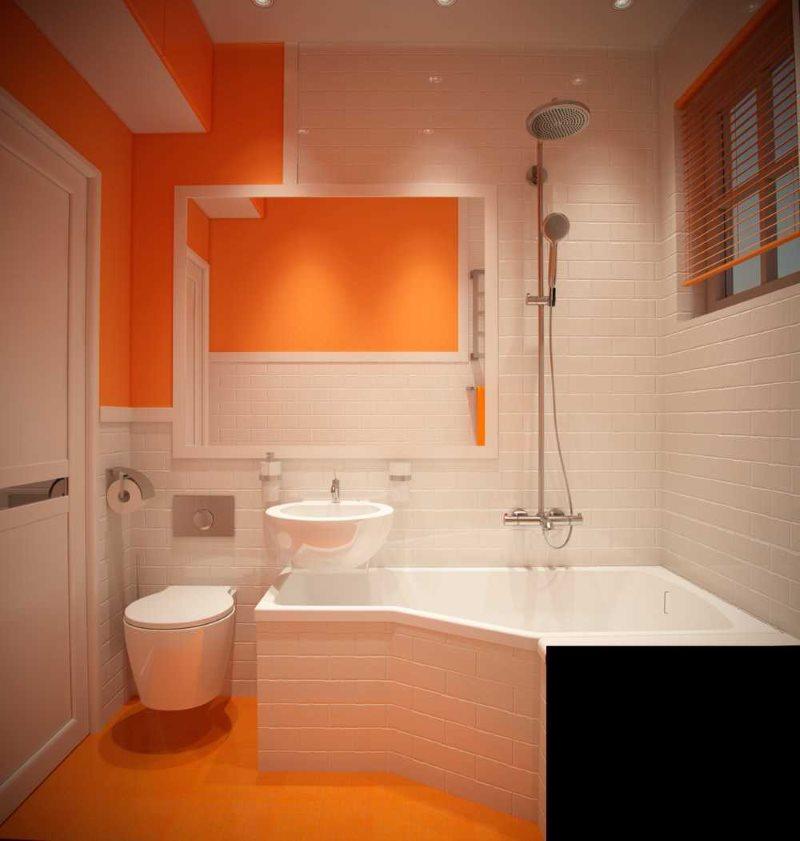 Оранжевый цвет в интерьере компактной ванной комнаты