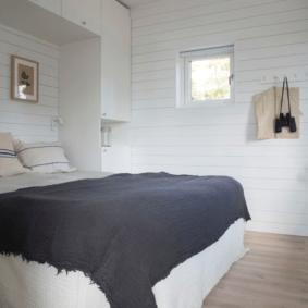 шкафы над кроватью в спальне фото оформления