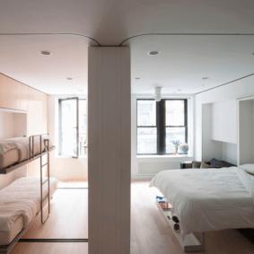 шкафы над кроватью в спальне оформление
