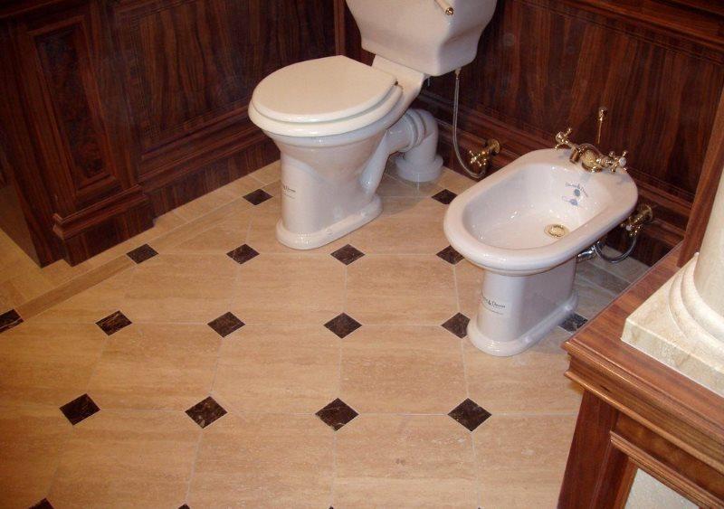 Теплый керамический пол в ванной комнате с биде