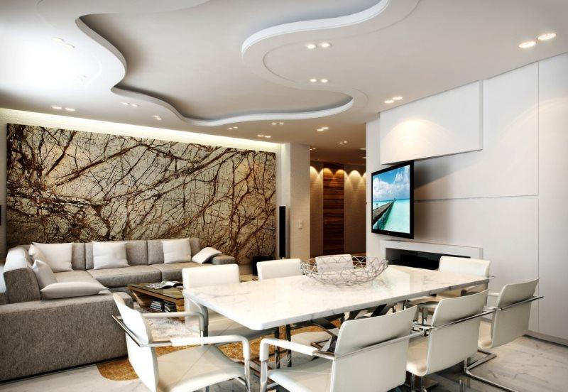 Интерьер современной кухни-гостиной с оригинальным потолком
