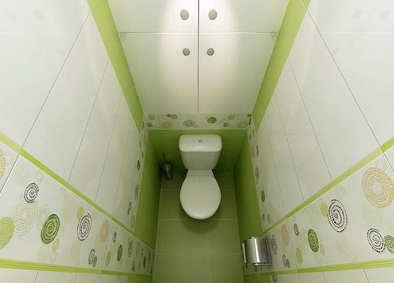 Зеленый пол туалета с белым унитазом
