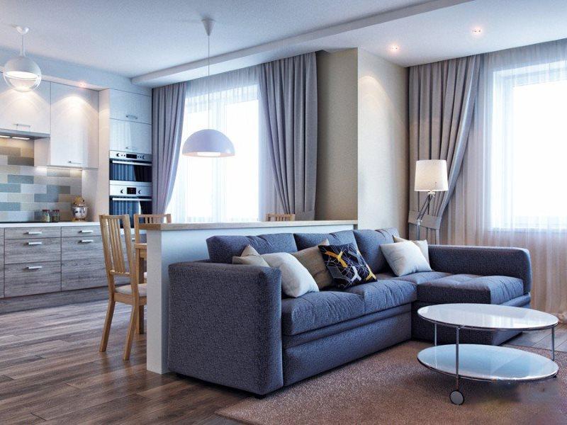 Угловой диван посередине кухни-гостиной