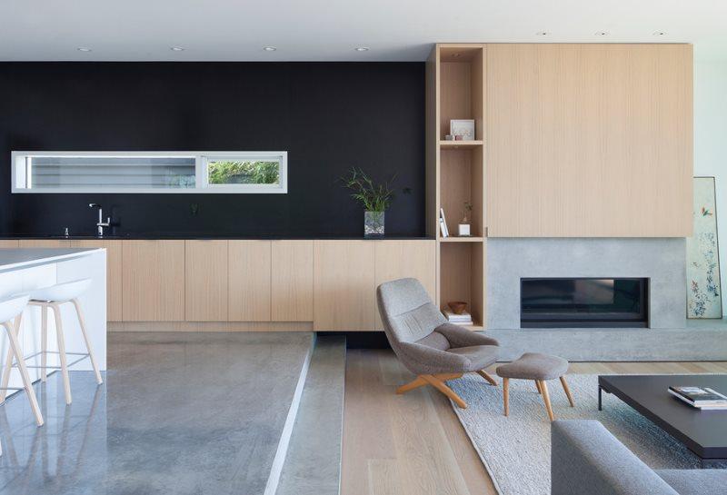 Зонирование кухни-гостиной с помощью подиума
