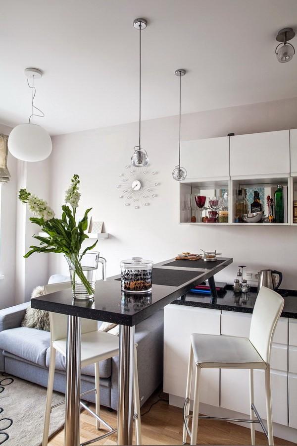 Черная барная стойка в кухне-гостиной площадью 12 кв м