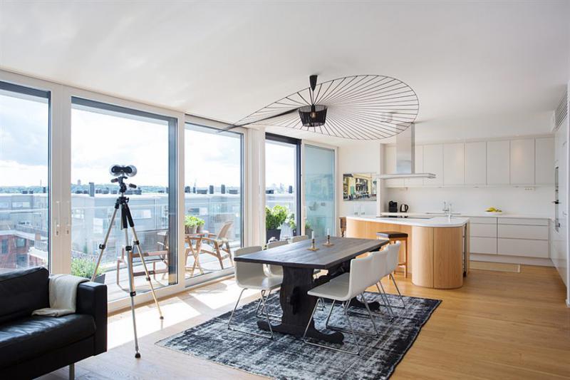Дизайн кухни-гостиной площадью 40 кв м с панорамным окном